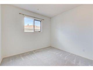 Photo 14: 313 WINDSOR Avenue: Turner Valley House for sale : MLS®# C4099234