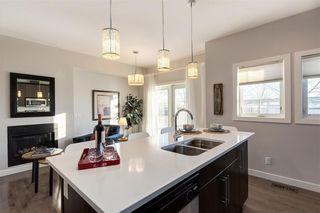 Photo 9: 312 QUARRY Villa SE in Calgary: Douglasdale/Glen Row/Townhouse for sale : MLS®# C4224154