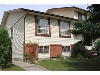 Photo 1: 3136 109 Avenue SW in CALGARY: Cedarbrae Residential Attached for sale (Calgary)  : MLS®# C3483655