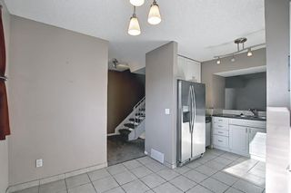 Photo 6: 1002 919 38 Street NE in Calgary: Marlborough Row/Townhouse for sale : MLS®# A1140399