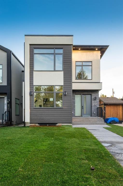 Main Photo: 215 22 Avenue NE in Calgary: Tuxedo Park Detached for sale : MLS®# A1144401