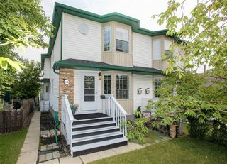 Photo 1: 2 6408 BOWWOOD Drive NW in Calgary: Bowness Row/Townhouse for sale : MLS®# C4241912