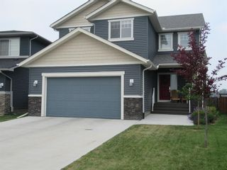 Photo 2: 1447 Aldrich Place: Carstairs Detached for sale : MLS®# A1130977