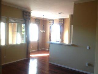 Photo 1: CARMEL VALLEY Condo for sale : 2 bedrooms : 3824 Elijah Court #101 in San Diego