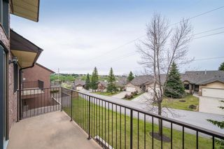 Photo 2: 85 Edgeland Road NW in Calgary: Edgemont Row/Townhouse for sale : MLS®# A1103490