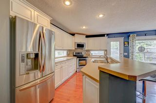 Photo 6: 34 Rockbluff Close NW in Calgary: Rocky Ridge Detached for sale : MLS®# A1123791