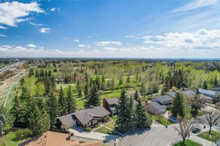 Photo 2: 587 WOODPARK Crescent SW in Calgary: Woodlands Detached for sale : MLS®# C4243103