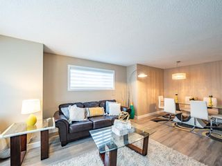 Photo 5: 27 Sandarac Road NW in Calgary: Sandstone Valley Row/Townhouse for sale : MLS®# A1148451