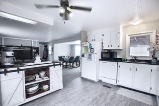 Photo 5: 128 Big Springs Drive SE: Airdrie Detached for sale : MLS®# A1117897