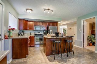 Photo 13: 8736 TULSY Crescent in Surrey: Queen Mary Park Surrey House for sale : MLS®# R2192315