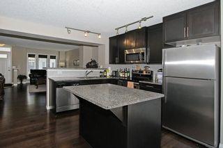 Photo 13: 105 AUBURN BAY Square SE in Calgary: Auburn Bay House for sale : MLS®# C4141384