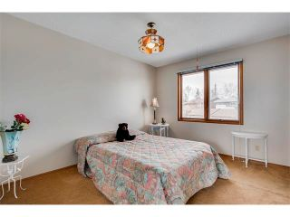 Photo 20: 27 COACHWOOD Place SW in Calgary: Coach Hill House for sale
