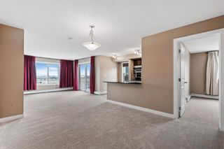 Photo 4: 7411 403 Mackenzie Way SW: Airdrie Apartment for sale : MLS®# A1152134