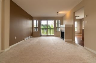 """Photo 6: 409 2958 WHISPER Way in Coquitlam: Westwood Plateau Condo for sale in """"SUMMERLIN"""" : MLS®# R2575108"""