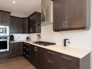 Photo 7: 46 RIVIERA Way: Cochrane Row/Townhouse for sale : MLS®# C4281559