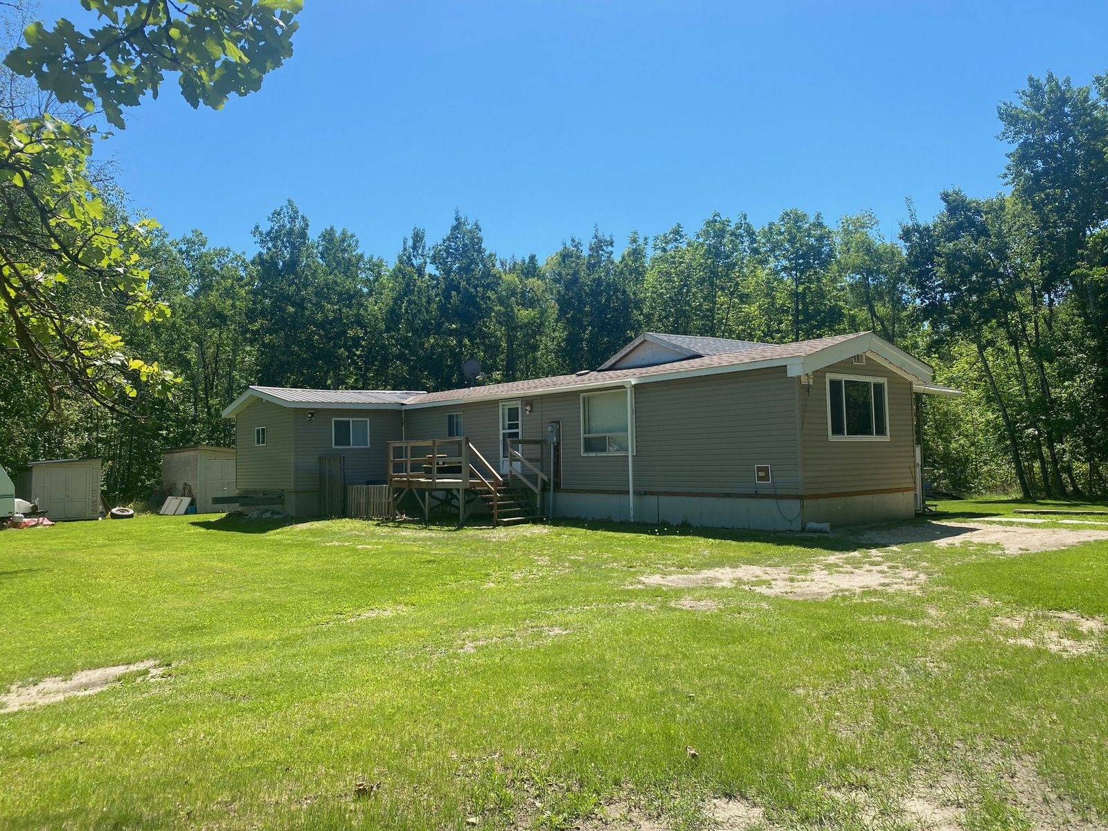 Main Photo: 57149 Road 33 W in Portage la Prairie RM: House for sale : MLS®# 202115033