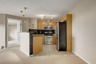Photo 3: 2308 8 BRIDLECREST Drive SW in Calgary: Bridlewood Condo for sale