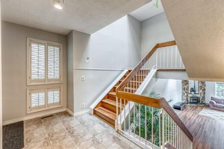 Photo 3: 10 Coach  Manor Rise SW in Calgary: Coach Hill Row/Townhouse for sale : MLS®# A1077472