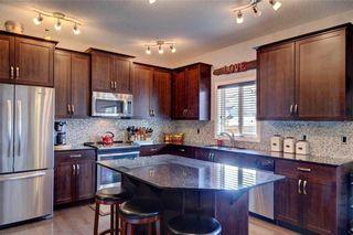Photo 15: 312 CIMARRON VISTA Way: Okotoks House for sale : MLS®# C4131376