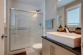 Photo 21: 15 West Coach Manor SW in Calgary: West Springs Row/Townhouse for sale : MLS®# A1100327