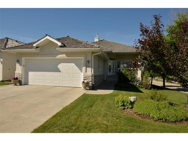 Main Photo: 134 GLENEAGLES View: Cochrane House for sale : MLS®# C4018773