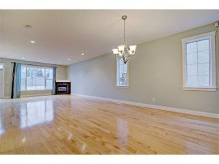 Photo 4: 176 MIKE RALPH Way SW in Calgary: Garrison Green House for sale : MLS®# C4091127