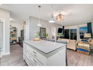 """Photo 9: 105 16380 64 Avenue in Surrey: Cloverdale BC Condo for sale in """"The Ridgse and Bose Farms"""" (Cloverdale)  : MLS®# R2556734"""