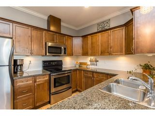 """Photo 10: 401 33338 MAYFAIR Avenue in Abbotsford: Central Abbotsford Condo for sale in """"THE STERLING"""" : MLS®# R2617623"""
