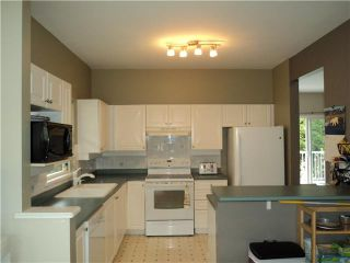 Photo 2: # 18 1765 PADDOCK DR in Coquitlam: Westwood Plateau Condo for sale : MLS®# V1111554