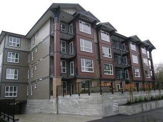 Photo 1: 204 2351 KELLY AVENUE in LA VIA: Home for sale