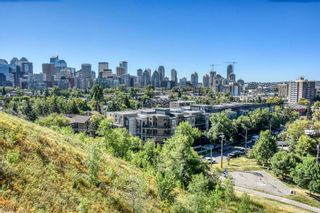 Photo 1: 118 823 5 Avenue NW in Calgary: Sunnyside Apartment for sale : MLS®# A1090115