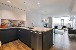 Photo 3: 405 519 Riverfront Avenue SE in Calgary: Downtown East Village Apartment for sale : MLS®# A1081632