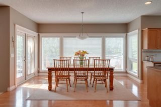 Photo 8: 140 Strathlea Place SW in Calgary: Strathcona Park Detached for sale : MLS®# A1145407