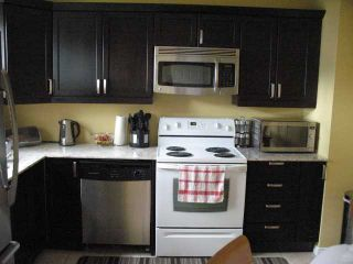 Photo 12: 3121 DOVER Crescent SE in CALGARY: Dover Residential Attached for sale (Calgary)  : MLS®# C3529265