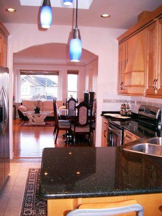 Photo 4: 3040 E 4TH AV in Vancouver: Home for sale : MLS®# V579539
