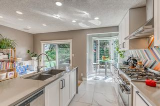 Photo 10: 1414 2 Street NW in Calgary: Crescent Heights Detached for sale : MLS®# A1129267