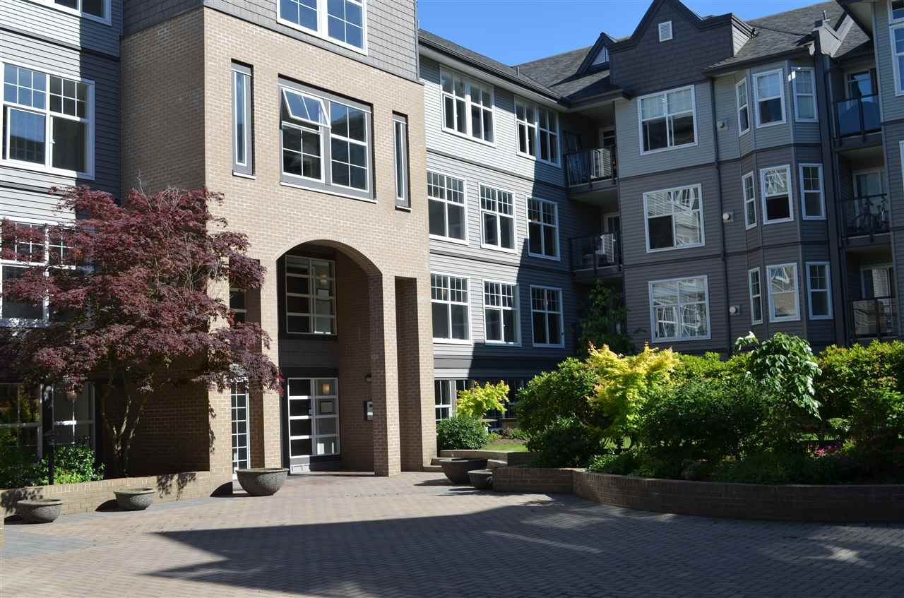 """Main Photo: 213 20200 56 Avenue in Langley: Langley City Condo for sale in """"THE BENTLEY"""" : MLS®# R2068739"""