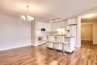 Photo 7: 509 55 ARBOUR GROVE Close NW in Calgary: Arbour Lake Apartment for sale : MLS®# A1096357