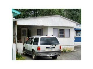 """Photo 1: 49 4200 DEWDNEY TRUNK Road in Coquitlam: Ranch Park Manufactured Home for sale in """"HIDEAWAY PARK"""" : MLS®# V902825"""
