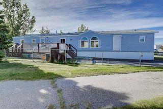 Photo 1: 97 1101 84 Street NE in Calgary: Abbeydale Mobile for sale : MLS®# A1036614