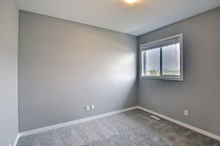 Photo 35: 566 River Heights Crescent: Cochrane Semi Detached for sale : MLS®# A1129968
