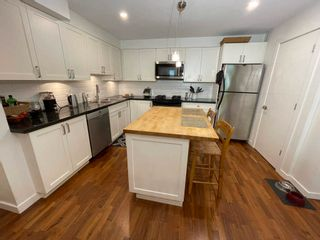 """Photo 8: 3685 W 12TH Avenue in Vancouver: Kitsilano Townhouse for sale in """"TWENTY ON THE PARK"""" (Vancouver West)  : MLS®# R2600219"""
