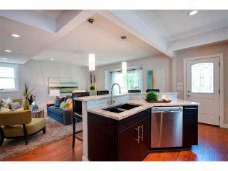 Photo 3: 1049 REGAL Crescent NE in Calgary: Renfrew_Regal Terrace House for sale : MLS®# C4013292