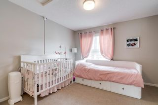 Photo 27: 235 ASCOT Circle SW in Calgary: Aspen Woods Row/Townhouse for sale : MLS®# A1025064