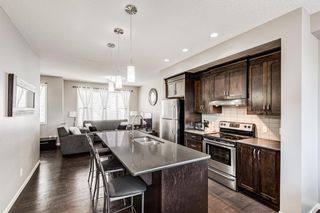 Photo 2: 504 Panatella Walk NW in Calgary: Panorama Hills Row/Townhouse for sale : MLS®# A1153133