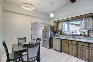 Photo 11: 335 Queensland Place SE in Calgary: Queensland Detached for sale : MLS®# A1137041