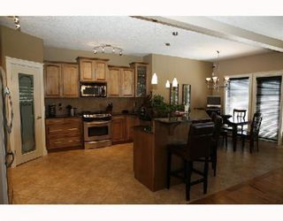 Photo 5: 25 West Cedar Point SW in Calgary: West Springs Detached for sale : MLS®# A1068967
