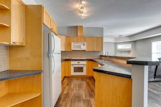 Photo 4: 105 6600 Old Banff Coach Road SW in Calgary: Patterson Apartment for sale : MLS®# A1142753