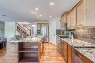 Photo 9: 7760 Springbank Way SW in Calgary: Springbank Hill Detached for sale : MLS®# A1132357