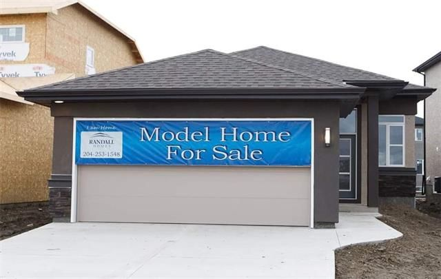 Great curb appeal, wide concrete drive, piled & poured sidewalk and nice covered entry with bright transom window above entry! Exterior not exactly the same as photo.
